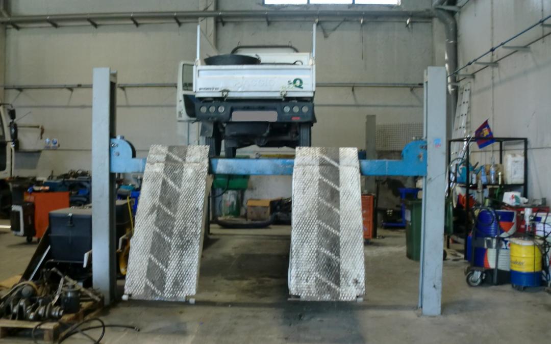 Licencia de actividad para taller mecánico de reparación de automóviles y camiones
